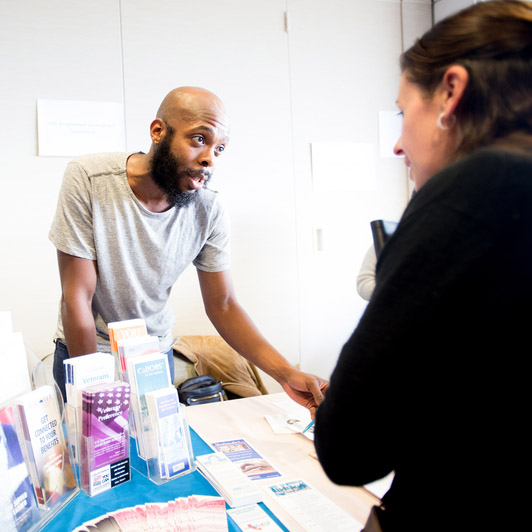 A UCSF employee helps an applicant at a veterans' job fair
